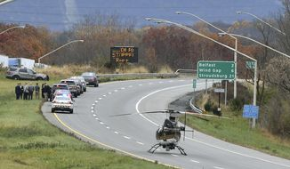 Emergency personal respond to the scene where a Pennsylvania State Police corporal was shot in Northampton County, Pa., Tuesday, Nov. 7, 2017. The corporal was shot several times while exchanging gunfire with a suspect during a traffic stop Tuesday morning, and the suspect was also wounded, authorities said. (April Gamiz/The Morning Call via AP)