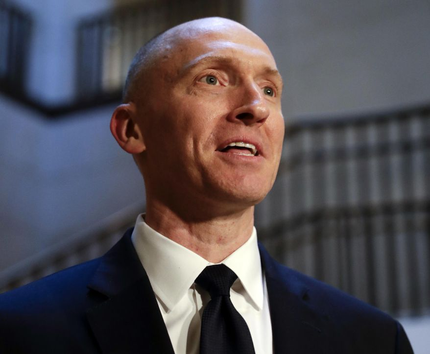 In this Nov. 2, 2017, file photo, Carter Page, a foreign policy adviser to Donald Trump's 2016 presidential campaign, speaks with reporters following a day of questions from the House Intelligence Committee, on Capitol Hill in Washington. (AP Photo/J. Scott Applewhite) ** FILE **
