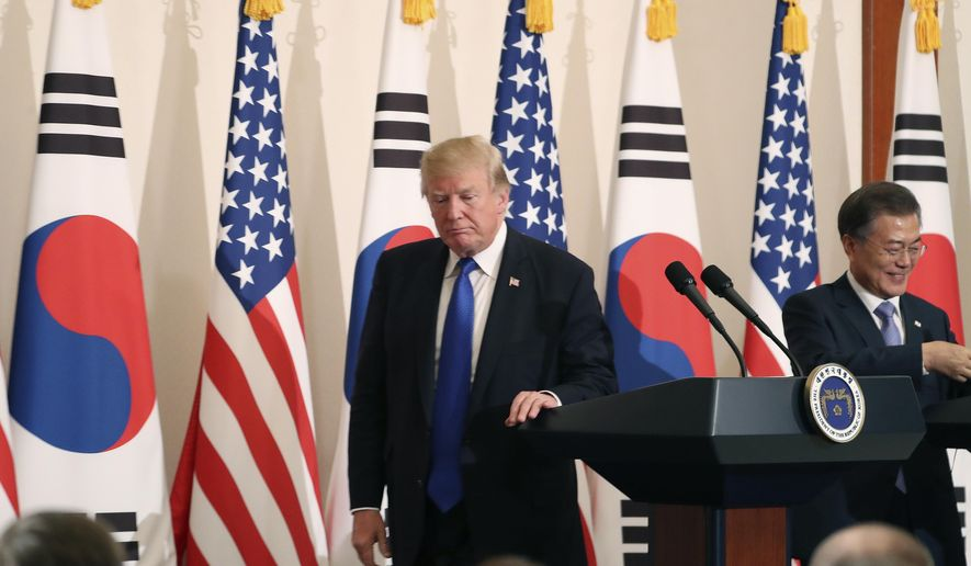President Donald Trump, left, leaves a joint news conference with South Korean President Moon Jae-in, right, at the Blue House in Seoul, South Korea, Tuesday, Nov. 7, 2017. President Trump began his two-day Korean peninsula visit Tuesday walking amid weapons of war but voicing optimism for peace. Trump is on a five country trip through Asia traveling to Japan, South Korea, China, Vietnam and the Philippines. (AP Photo/Andrew Harnik)
