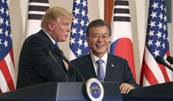 President Donald Trump, left, speaks as South Korean President Moon Jae-in looks on during a joint news conference at the Blue House in Seoul, South Korea, Tuesday, Nov. 7, 2017. (AP Photo/Andrew Harnik) ** FILE **