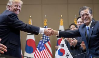 President Donald Trump, left,  and South Korean President Moon Jae-in shake hands during a bilateral meeting at the Blue House in Seoul, South Korea, Tuesday, Nov. 7, 2017. Trump is on a five country trip through Asia traveling to Japan, South Korea, China, Vietnam and the Philippines. (AP Photo/Andrew Harnik)