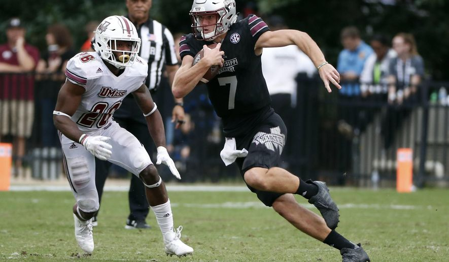 Mississippi State quarterback Nick Fitzgerald (7) runs for a first down past Massachusetts linebacker Jarell Addo (26) in the second half of an NCAA college football game against in Starkville, Miss., Saturday, Nov. 4, 2017. No. 21 Mississippi State won 34-23. (AP Photo/Rogelio V. Solis)