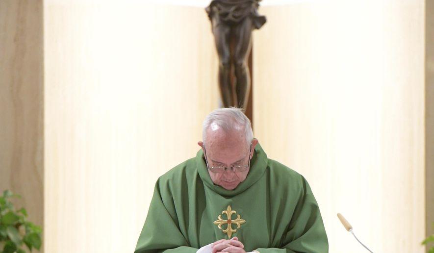 Pope Francis celebrates Mass at this Santa Marta residence at the Vatican, Tuesday, Nov. 7, 2017. (L'Osservatore Romano/Pool Photo via AP)