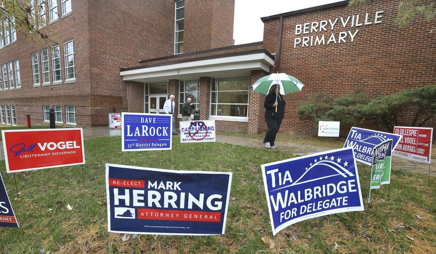 Voters exit a Berryville, Va. polling station on Tuesday Nov. 7, 2017, in this file photo. (Ginger Perry /The Winchester Star via AP)