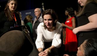 Republican candidate for Lt. Gov. State Sen. Jill Vogel, center, greets supporters after a concession speech during an election party in Richmond, Va., Tuesday, Nov. 7, 2017. Vogel lost to Democrat Justin Fairfax. (AP Photo/Steve Helber)