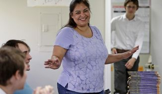 FILE - In this Aug. 22, 2017, file photo, Manka Dhingra, candidate for 45th district Senate seat, talks with volunteers at her campaign headquarters in Redmond, Wash. Voters in the suburbs east of Seattle will determine whether the Washington state Senate will remain the only Republican-led legislative chamber on the West Coast. Democrat Dhingra and Republican Jinyoung Lee Englund are seeking to serve the last year of a four-year term left vacant by the death of Republican Sen. Andy Hill. (AP Photo/Elaine Thompson, File)