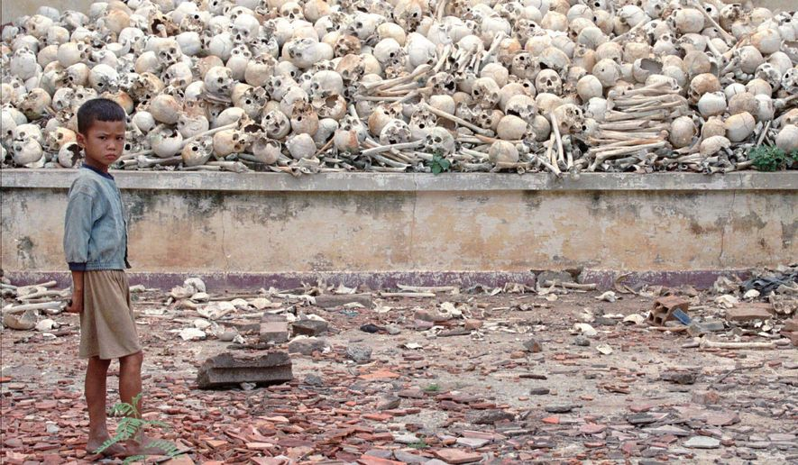 This Cambodian boy visits a platform covered with human skulls but likely knows little else about the killing fields of the Khmer Rouge, the communists in power who slaughtered nearly 1 million people in his country during their brutal reign from 1975-1978. (Associated Press/File)