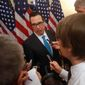 "Treasury Secretary Steven T. Mnuchin is part of the ""Tax Team,"" which is keeping up the PR campaign for tax reform during President Trump's travels to Asia. (Associated Press)"