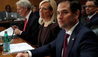 """""""We will enforce our laws. It's vital we do so. We will do so,"""" said Kirstjen M. Nielsen, President Trump's pick to be the next Homeland Security secretary on Wednesday. (Associated Press)"""