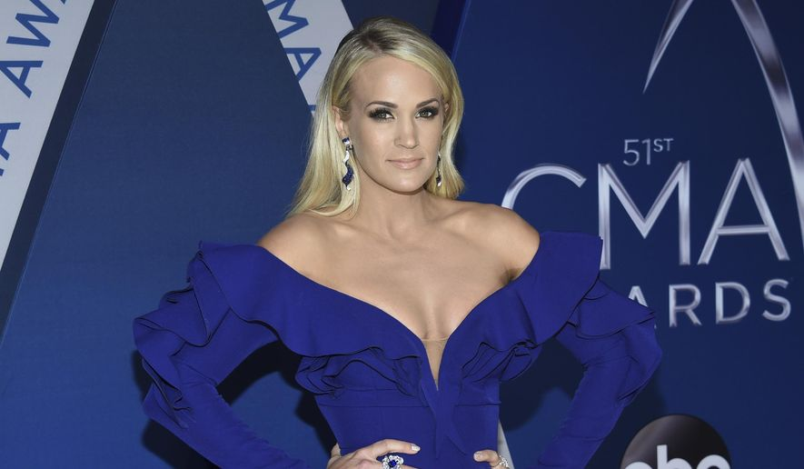 Carrie Underwood arrives at the 51st annual CMA Awards on Wednesday, Nov. 8, 2017, in Nashville, Tenn. (Photo by Evan Agostini/Invision/AP) ** FILE **