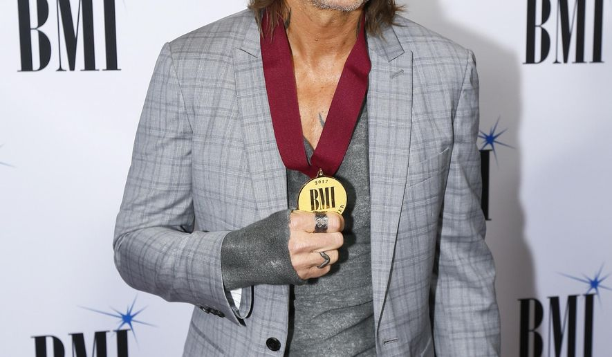 Keith Urban arrives at the BMI Awards at BMI Nashville on Tuesday, Nov. 7, 2017, in Nashville, Tenn. (Photo by Wade Payne/Invision/AP)