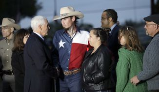 Vice President Mike Pence and his wife, Karen, talks with Johnnie Langendorff, and his girlfriend Summer Caddell, third from right, as they visit with first responders, family, friends and victims outside the Sutherland Spring Baptist Church Wednesday, Nov. 8, 2017, in Sutherland Springs, Texas. A man opened fire inside the church in the small South Texas community on Sunday, killing and wounding many. Pastor Frank Pomeroy and his wife Sherri are at right. (AP Photo/Eric Gay)