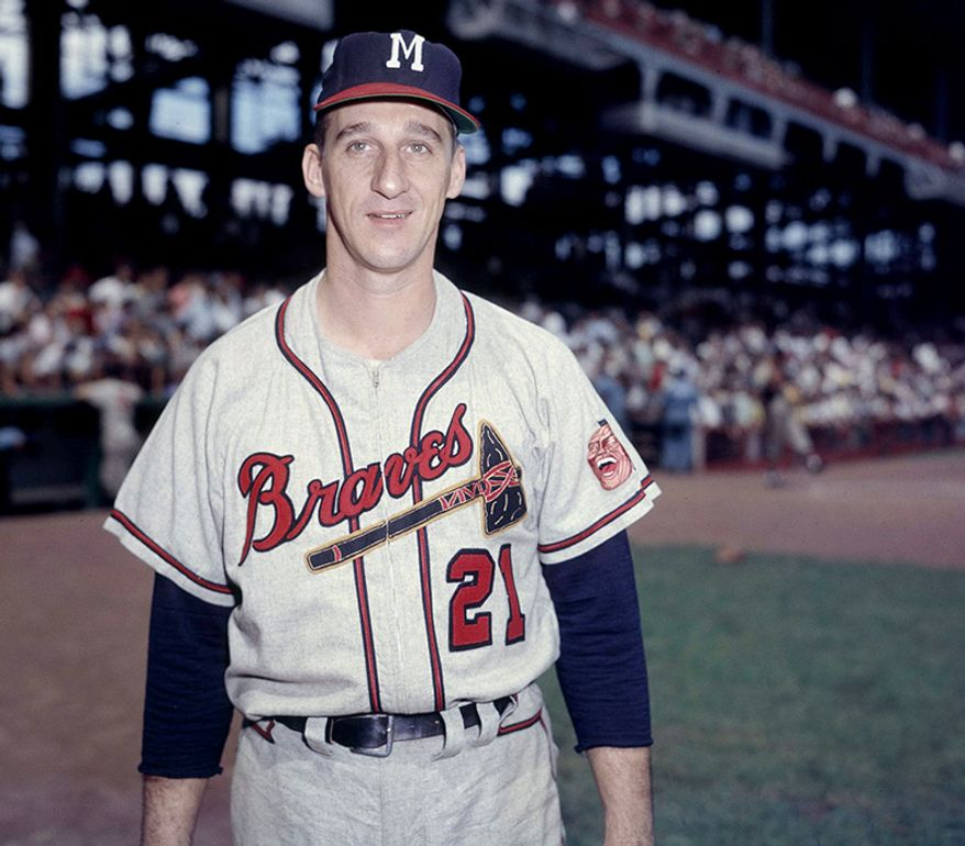 Warren Spahn played his entire 21-year baseball career in the National League. He won 20 games or more in 13 seasons, including a 23–7 record when he was age 42. Spahn was the 1957 Cy Young Award winner, and was the runner-up three times, all during the period when one award was given, covering both leagues. He was elected to the Baseball Hall of Fame in 1973, with 83% of the total vote. Spahn chose to enlist in the United States Army, after finishing the 1942 season in the minors. He served with distinction, and was awarded a Purple Heart. He saw action in the Battle of the Bulge and at the Ludendorff Bridge as a combat engineer, and was awarded a battlefield commission. Spahn returned to the major leagues in 1946 at the age of 25, having missed three full seasons. Had he played, it is possible that Spahn would have finished his career behind only Walter Johnson and Cy Young in all-time wins.