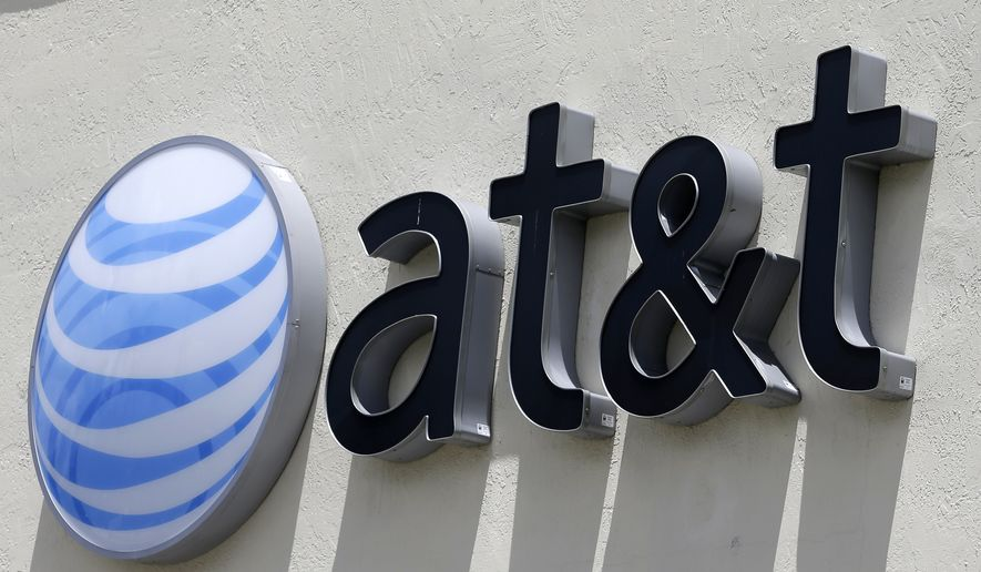 An AT&T sign is shown in this file photo. New Hampshire has announced it is opting out of FirstNet, a nationwide broadband public-safety communications system designed by AT&T. (AP Photo/Alan Diaz, File)
