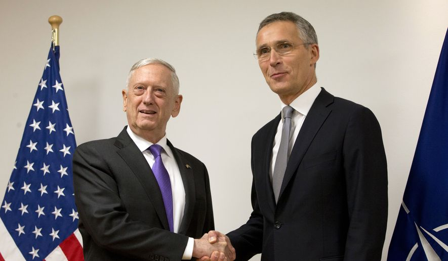 U.S. Secretary for Defense Jim Mattis, left, shakes hands with NATO Secretary General Jens Stoltenberg prior to a meeting on the sidelines of a NATO defense ministers meeting at NATO headquarters in Brussels on Wednesday, Nov. 8, 2017. NATO defense ministers start two days of talks looking to expand the military alliance's command structure and drum up more troop contributions for Afghanistan. (AP Photo/Virginia Mayo, Pool)
