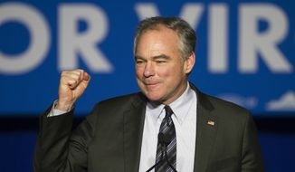 In this Tuesday, Nov. 7, 2017, file photo, Sen. Tim Kaine, D-Va., addresses the Northam For Governor election night party at George Mason University in Fairfax, Va. Democratic candidate Ralph Northam won Virginia's race for governor. (AP Photo/Cliff Owen) ** FILE **