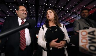 Republican National Committee Chairwoman Ronna Romney McDaniel speaks to reporters as Republican Party of Iowa Chairman Jeff Kaufmann, left, looks on before the Republican Party of Iowa's annual Reagan Dinner, Wednesday, Nov. 8, 2017, in Des Moines, Iowa. (AP Photo/Charlie Neibergall) ** FILE **