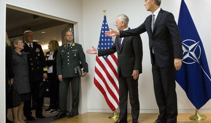 U.S. Secretary for Defense Jim Mattis, center, and NATO Secretary General Jens Stoltenberg, right, gesture to delegation members outside the room prior to a meeting on the sidelines of a NATO defense ministers meeting at NATO headquarters in Brussels on Wednesday, Nov. 8, 2017. NATO defense ministers start two days of talks looking to expand the military alliance's command structure and drum up more troop contributions for Afghanistan. (AP Photo/Virginia Mayo, Pool)