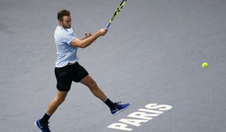 FILE - In this Nov. 5, 2017, file photo, Jack Sock returns the ball to Filip Krajinovic, of Serbia, during their final match of the Paris Masters tennis tournament in Paris, France. Sock compiled a 3-4 record at Grand Slam tournaments this year, making it as far as the third round only once. During one stretch at lower-tier events, he lost five consecutive matches. Still, the 25-year-old American turned things around at the end of the season, so much so that he ended up making his top-10 debut in the rankings and will be participating in the ATP Finals for the first time, starting with a match against 19-time major champion Roger Federer on Sunday in London. (AP Photo/Francois Mori, File)