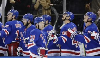New York Rangers' Jimmy Vesey (26) celebrates with teammates after scoring a goal during the first period of an NHL hockey game against the Boston Bruins on Wednesday, Nov. 8, 2017, in New York. (AP Photo/Frank Franklin II)