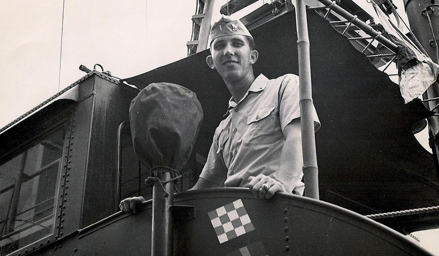 In this late-1960s photo released by the U.S. Coast Guard Academy, Lt. j.g. Kent Williams stands aboard the U.S. Coast Guard cutter Point Ellis in the waters of Vietnam. On Thursday, Nov. 9, 2017, the 74-year-old Williams is being inducted into the Hall of Heroes at the academy. He spent 32 years in the Coast Guard and retired as a vice admiral. (U.S. Coast Guard via AP)