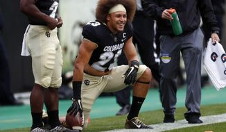 "FILE - In this Oct. 28, 2017, file photo, Colorado running back Phillip Lindsay (23) watches from the sideline during the first half of an NCAA college football game against California in Boulder, Colo. Lindsay arrived in Boulder coming off a severe and concerning knee injury. He also brought this: An infectious energy and robust work ethic. That knee injury never held him back and now the Colorado senior nicknamed ""Tasmanian Devil"" is on the verge of rewriting the school's rushing record. (AP Photo/David Zalubowski, File)"