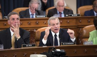 Rep. David Schweikert, R-Ariz., joined at left by Rep. Tom Rice, R-S.C., makes a point as the House Ways and Means Committee continues its debate over the Republican tax reform package, on Capitol Hill in Washington, Wednesday, Nov. 8, 2017. (AP Photo/J. Scott Applewhite)