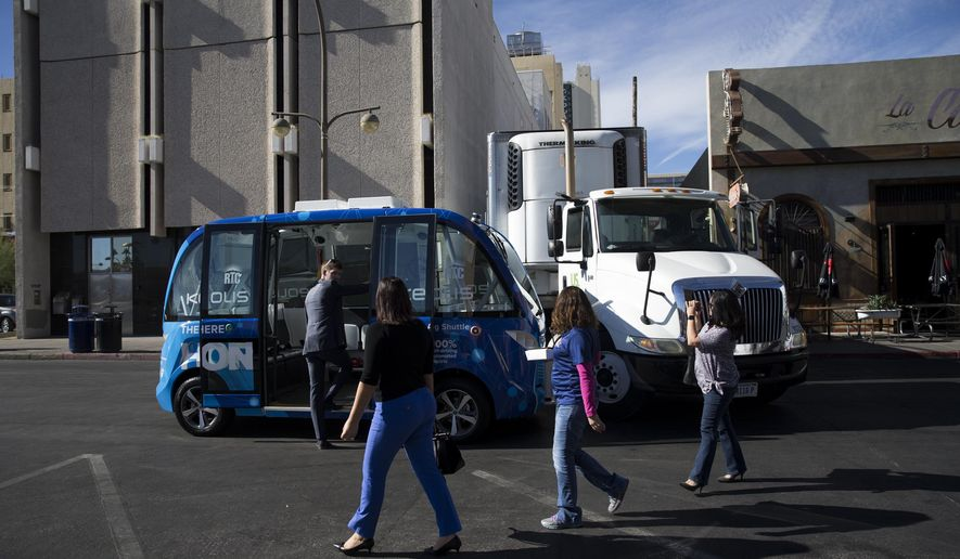 The scene of an accident between a self-driving shuttle and a truck in downtown Las Vegas, Wednesday, Nov. 8, 2017. The accident occurred just hours after the automated ride service was launched. (Erik Verduzco/Las Vegas Review-Journal via AP)