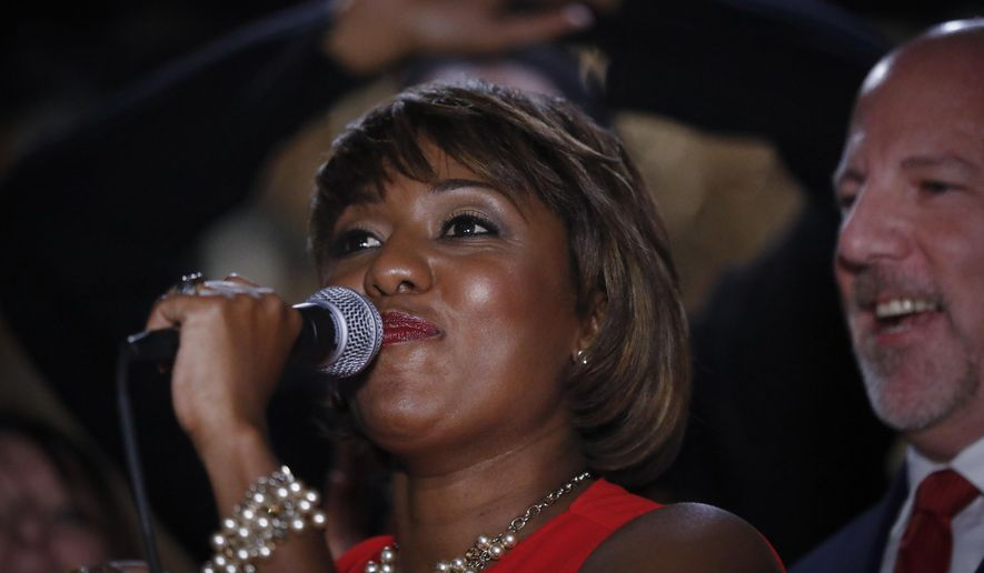 Cincinnati city council member and mayoral candidate Yvette Simpson gives her concession speech at her election night watch party at Queen City Radio, Tuesday, Nov. 7, 2017, in Cincinnati. (AP Photo/John Minchillo)