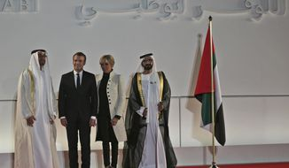 French President Emmanuel Macron, second left, with his wife, Brigitte, are received by Abu Dhabi Crown Prince Mohammed bin Zayed al-Nahayan, left, and and Dubai's ruler Sheikh Mohammed bin Rashid Al Maktoum, at the official opening of Louvre Abu Dhabi museum, Wednesday, Nov. 8, 2017, in Abu Dhabi, United Arab Emirates. (AP Photo/Kamran Jebreili)