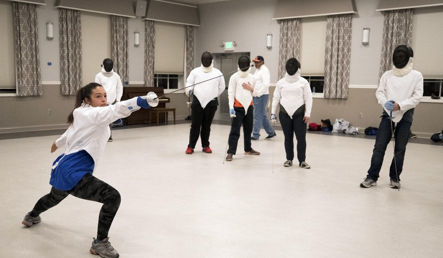 Glori Torres of Rochester, N.Y., demonstrates a fencing technique during a fencing practice at Keystone College on Monday, Oct. 30, 2017. (Christopher Dolan/The Times & Tribune via AP)