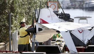 The remains of an ICON A5 ultralight airplane are moved from a boat ramp in the Gulf Harbors neighborhood of New Port Richey, Fla., on Wednesday, Nov. 8, 2017.  The private plane, which belonged to Roy Halladay had just been removed from the shallow waters off Ben Pilot Point in New Port Richey where it crashed Tuesday, killing the 40-year-old former Toronto Blue Jays and Philadelphia Phillies pitcher.   (Douglas R. Clifford/Tampa Bay Times via AP) **FILE**