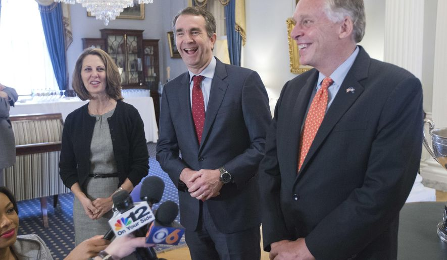 Virginia Gov. Terry McAuliffe, right, shares a laugh with Gov.-elect, Ralph Northam, center, as Pam Northam, left, looks on during a news conference in the Governors mansion at the Capitol in Richmond, Va., Wednesday, Nov. 8, 2017. (AP Photo/Steve Helber)