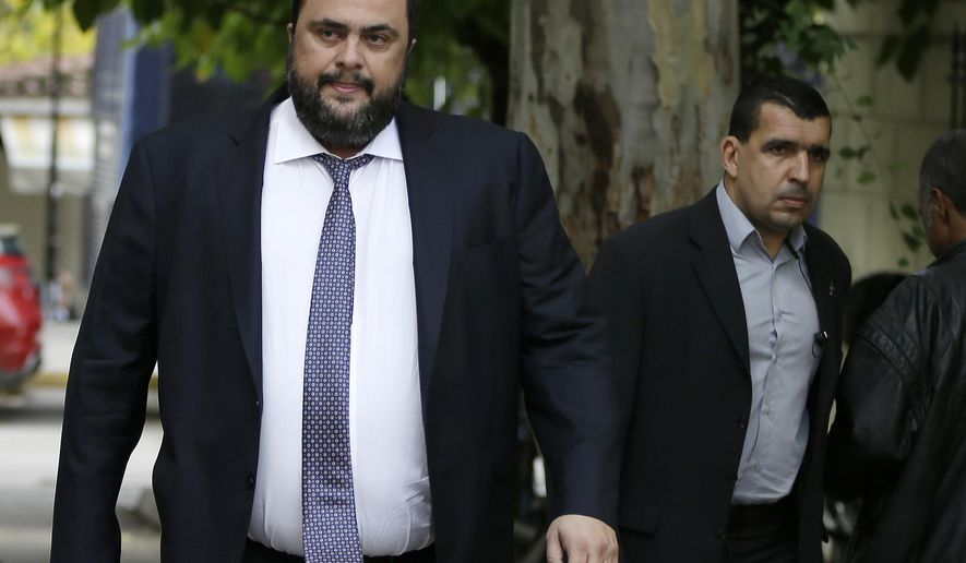 FILE - In this Wednesday, Nov. 19, 2014 file photo Olympiakos soccer club chairman Vangelis Marinakis appears in court in Athens. A court on Wednesday, Nov. 8, 2017 ordered the chairman of Greek soccer club Olympiakos and 27 other businessmen and former sporting officials will stand trial on match-fixing charges. (AP Photo/Thanassis Stavrakis, File)
