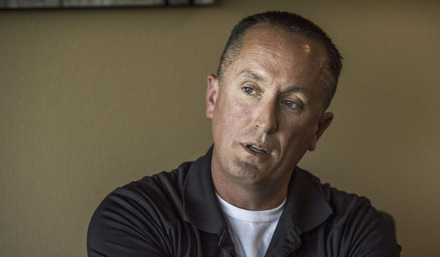 California Highway Patrol officer Chris Lutz talks at his attorney's office in Fresno on Wednesday, Oct. 25, 2017. He claims his managers in the CHP's Oakhurst office in Madera County have denied him time off for military assignments, harassed him with unfounded allegations and driven him to file a lawsuit against his employer.  (Hector Amezcua/The Sacramento Bee via AP)