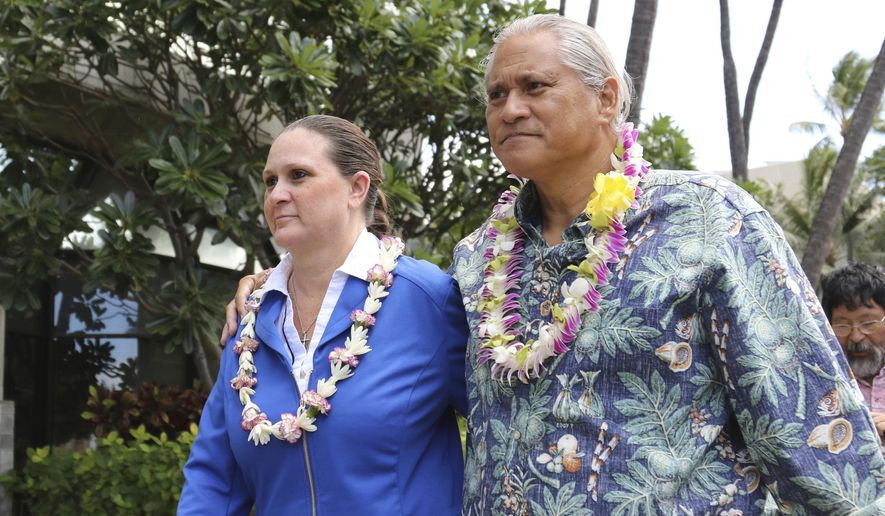 FILE - In this Oct. 20, 2017 file photo, former Honolulu Police Chief Louis Kealoha, right, and his wife, Katherine, leave federal court in Honolulu. Lawyers who have been representing Kealoha and his wife in a corruption case say the couple can't afford to pay them. The lawyers suggest that the Kealoha's receive court-appointed defense attorneys from outside Hawaii. The motion says the Kealohas can no longer fund a defense. They're accused of framing a relative in an attempt to discredit him in a financial dispute. Katherine Kealoha is accused of bilking relatives and others to fund a lavish lifestyle. (AP Photo/Caleb Jones, File)