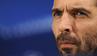 FILE -- In this Feb. 21, 2017 file photo, Juventus goalkeeper Gianluigi Buffon listens to questions during a news conference at the Dragao stadium in Porto, Portugal. Twenty years after he made his Italy debut on a snowy pitch in a World Cup playoff in Russia, the Azzurri captain's international future hinges on another playoff against Sweden. If Italy advances, Buffon can conclude his Italy career where it started at next year's tournament in Russia. A loss would almost certainly mark his final appearance for the national team. (AP Photo/Paulo Duarte)