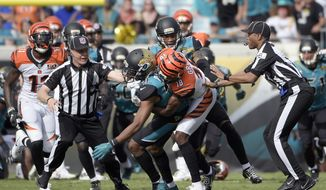 FILE - In this Sunday, Nov. 5, 2017, file photo, Cincinnati Bengals wide receiver A.J. Green (18) takes down Jacksonville Jaguars cornerback Jalen Ramsey (20) during a fight in the first half of an NFL football game in Jacksonville, Fla. Ramsey and running back Leonard Fournette  are expected to speak publicly Wendesday, Nov. 8, 2017,  for the first time since Ramsey's ejection for fighting and Fournette's violation of team rules that got him benched for a game. (AP Photo/Phelan M. Ebenhack, File)