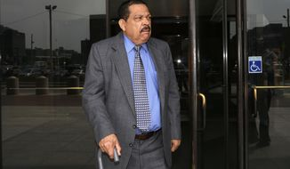FILE - In this Aug. 22, 2013 file photo, former El Salvadoran military Col. Inocente Orlando Montano departs federal court, in Boston.   U.S. Solicitor General Noel Francisco urged the high court on Wednesday, Nov. 8, 2017,  to clear the final hurdle to send Inocente Orlando Montano Morales to Spain on charges that he helped plot the 1989 killings of six Jesuit priests, five of whom were Spanish. (AP Photo/Steven Senne, File)