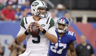 FILE - In this Aug. 26, 2017, file photo, New York Jets quarterback Christian Hackenberg (5) looks to pass during the first half of a preseason NFL football game against the New York Giants in East Rutherford, N.J. Hackenberg remains a big mystery for the New York Jets. The second-year quarterback has yet to take a snap in a regular-season game, and it appears he won't get an opportunity any time soon. Hackenberg is the Jets' No. 3 quarterback, stuck behind backup Bryce Petty and 38-year-old starter Josh McCown. (AP Photo/Julio Cortez, File)