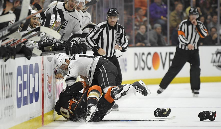 Anaheim Ducks right wing Jared Boll, below, and Los Angeles Kings left wing Andy Andreoff go into the boards as they fight during the second period of an NHL hockey game, Tuesday, Nov. 7, 2017, in Anaheim, Calif. (AP Photo/Mark J. Terrill)