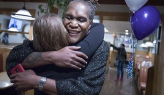 Andrea Jenkins hugs a supporter as she won the Minneapolis Ward 8: Council Member race in Minneapolis on Tuesday, Nov. 7, 2017. (Carlos Gonzalez/Star Tribune via AP)