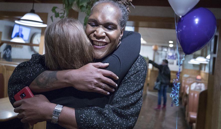 Andrea Jenkins hugs a supporter as she won the Minneapolis Ward 8: Council Member race in Minneapolis on Tuesday, Nov. 7, 2017. (Carlos Gonzalez/Star Tribune via AP)