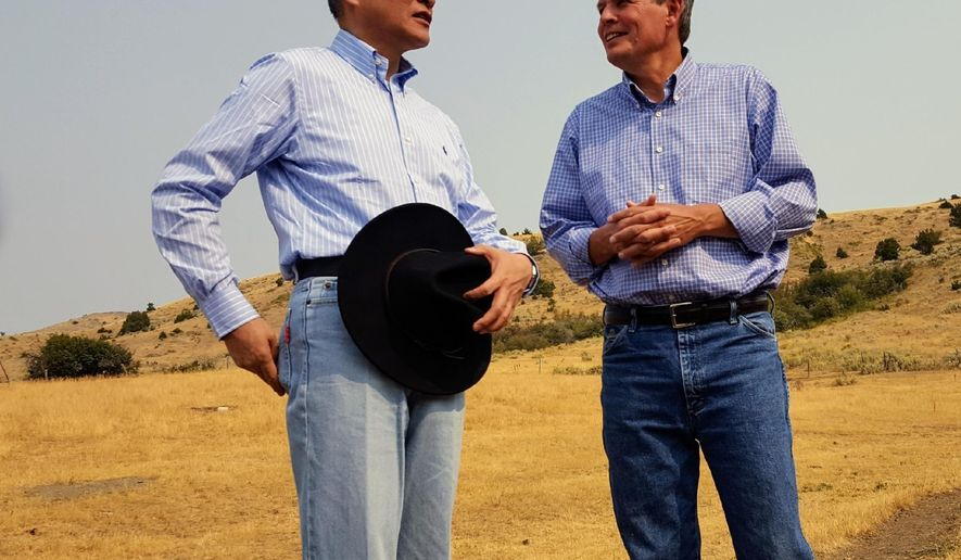 In this Sept. 8, 2017 photo, Chinese ambassador to the United States Cui Tiankai, left, speaks with Republican Montana Sen. Steve Daines about ways to expand the Chinese market for Montana beef. The two met with other Chinese and Montana agriculture officials during a tour of a ranch in the Bozeman area. China's largest online retailer has signed a deal with the Montana Stockgrowers Association to buy $200 million worth of Montana beef over the next three years and to build a $100 million slaughterhouse in the state. (Tom Lutey Gazette Staff/The Billings Gazette via AP)
