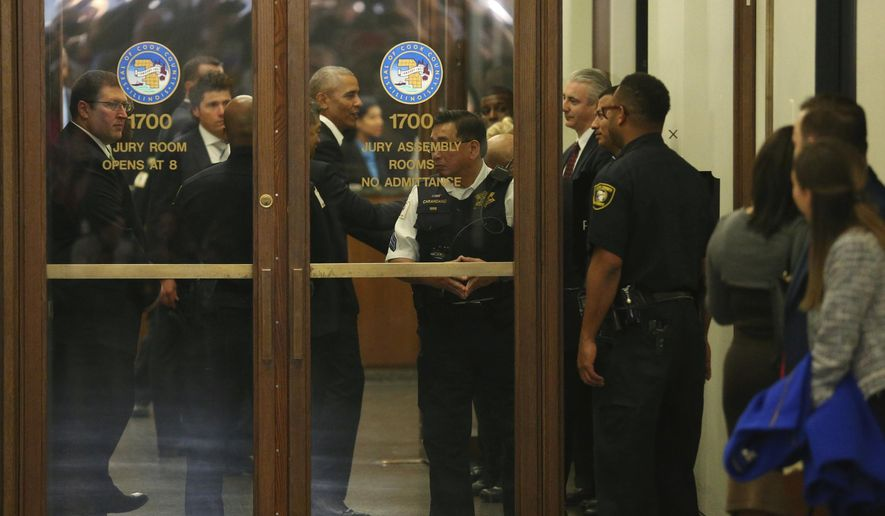Former President Barack Obama arrives for jury duty in the Daley Center on Wednesday, Nov. 8, 2017, in Chicago.  Obama is in line to be paid the same $17.20 a day that others receive for reporting for jury duty. (Nancy Stone/Chicago Tribune via AP)