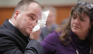 Anthony Sanborn wipes his eyes as the details of an agreement with the state are announced at the Cumberland County Courthouse in Portland on Wednesday, Nov. 8, 2017. Sanborn, who was convicted of the 1989 murder of 16-year-old Jessica Briggs, served 27 years of his 70-year sentence. He and the state reached a deal Wednesday after a weeks-long post-conviction review in which his attorneys questioned the integrity of the police investigation, and several witnesses recanted. (Gregory Rec/Portland Press Herald via AP)