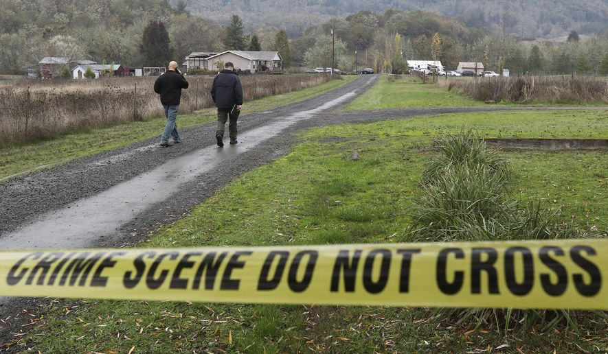 Investigators work at the scene of an alleged homicide, Wednesday Nov. 8, 2017 in Lookingglass, Ore. Authorities arrested a 16-year-old boy accused of fatally shooting three people in southwest Oregon. (Michael Sullivan/The News-Review via AP)