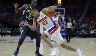 Detroit Pistons guard Avery Bradley (22) drives on Indiana Pacers guard Darren Collison (2) during the first half of an NBA basketball game, Wednesday, Nov. 8, 2017, in Detroit. (AP Photo/Carlos Osorio)