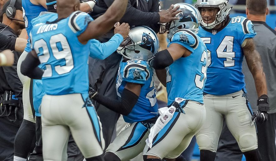FILE - In this Sunday, Nov. 5, 2017, file photo, the Carolina Panthers defense celebrate by lifting assistant defensive backs/safeties coach Richard Rodgers along the sidelines after they stopped the Atlanta Falcons on fourth down in the second half of an NFL football game in Charlotte, N.C. The Panthers have always been a strong defense under Ron Rivera, but they're back to be being No. 1 behind the help of some veteran players. (AP Photo/Bob Leverone, File)