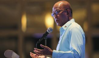 "Philippine Secretary of National Defense Delfin Lorenzana gestures during a conference on ""ASEAN Leadership amid a New World Order"" at the financial district of Makati, metropolitan Manila, Philippines Wednesday, Nov. 8, 2017. Lorenzana says Philippine President Rodrigo Duterte has stopped construction work on a newly formed sandbar in the disputed South China Sea after a protest from Beijing. (AP Photo/Aaron Favila)"